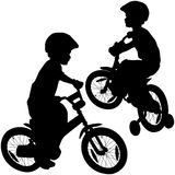 Boy and bicycle. Little boy and bicycle silhouettes Stock Images