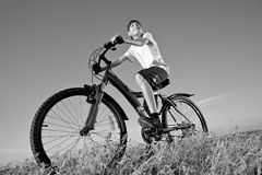 The boy with a bicycle Stock Images