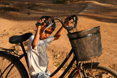 Boy with a bicycle Stock Photos