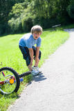 Boy with a bicycle Royalty Free Stock Images