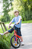 Boy with a bicycle Royalty Free Stock Photos