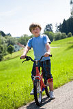 Boy with a bicycle Stock Photo