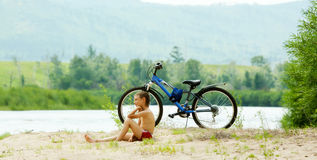Boy with bicycle Royalty Free Stock Photo