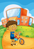 A boy and bicycle Royalty Free Stock Photography
