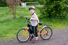 Boy on bicycle Stock Photography