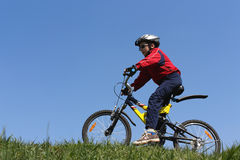 Boy on bicycle. On top of the hill Royalty Free Stock Photos