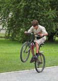 Boy on the bicycle. Boy jumps on the bicycle on summer day Royalty Free Stock Image