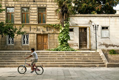 Boy on bicycle in baku azerbaijan Stock Image