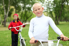Boy on a bicycle in the green park Stock Photography