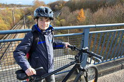 Boy with bicycle and helmet Stock Photography