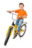 Boy on bicycle Stock Photos