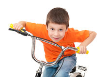 Boy on bicycle isolated Stock Photos
