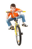 Boy on bicycle isolated Royalty Free Stock Images