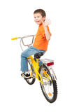 Boy on bicycle isolated Stock Photography