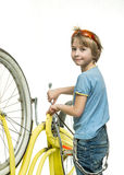 Boy with bicycle Stock Images