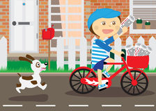 Boy on bicycle,  messenger of newspapers. Running dog Royalty Free Stock Image