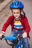 Boy on the bicycle at Park Stock Images