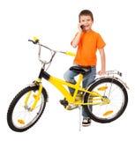 Boy on bicycle Stock Photos