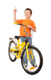 Boy on bicycle point at Royalty Free Stock Photo