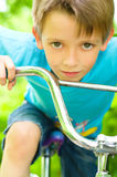 Boy on bicycle. Portrait of a cute boy on bicycle Stock Image