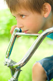 Boy on bicycle. Portrait of a cute boy on bicycle Royalty Free Stock Photo