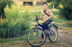 Boy on a bicycle Stock Photography