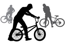 Boy with a bicycle. A boy rides a bicycle on a walk.  Silhouette on a white background Royalty Free Stock Photo