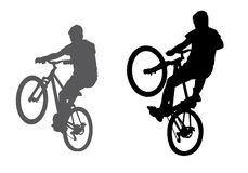 Boy with a bicycle. A boy rides a bicycle on a walk.  Silhouette on a white background Stock Photos