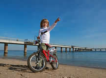 Boy with bicycle on sea beach Stock Image