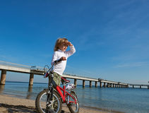 Boy with bicycle on sea outdoor Stock Images