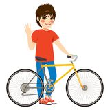 Boy Bicycle Standing. Teenager boy standing with bicycle wearing casual clothes saluting waving hand vector illustration