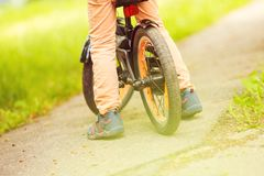 Boy with a bicycle on the street. Wheel of a children`s bicycle royalty free stock photos