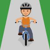 Boy on a bicycle to roll downhill Stock Image
