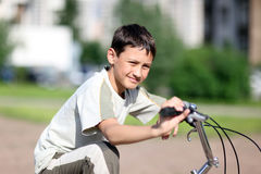 Boy at bicycle Stock Photography