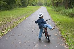 Boy Bicycling_7805-1S. Boy Getting Ready to Mount His Bike Stock Photography