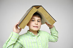 Boy with big book . Royalty Free Stock Photography