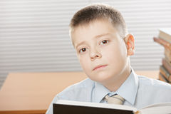 Boy with big book Royalty Free Stock Images