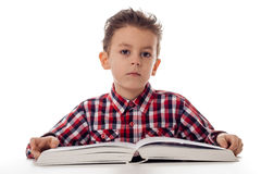 Boy with big book Stock Photos