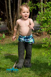 Boy with big boots Royalty Free Stock Photography