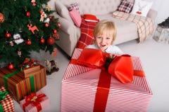 Boy with a big Christmas gift Royalty Free Stock Image