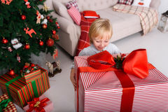 Boy with a big Christmas gift Royalty Free Stock Photography