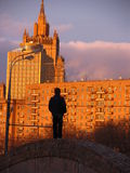 Boy in big city. Boy from farm first time in big sity. He watch at city buildings Stock Image