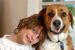 Boy and big dog. A boy snuggling with his big dog royalty free stock photography