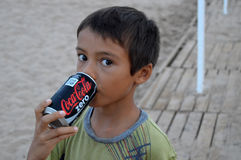 Boy With Big Eyes Drinking A Can Of Coke Royalty Free Stock Photo