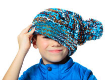 Boy with big hat. Seven years boy with stylish hat on his face isolated on white background Stock Photography