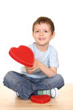 Boy with big heart. Five years boy with big red heart isolated on white Stock Photo