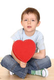 Boy with big heart. Five years boy with big red heart isolated on white Royalty Free Stock Image