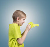Boy with a big key Stock Images