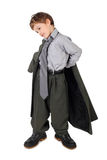 Boy in big man's suit and boots dressing jacket Stock Photography