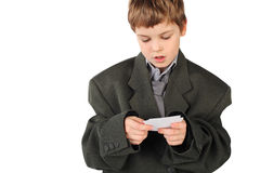 Boy in big man's suit looking at  business card Stock Photos